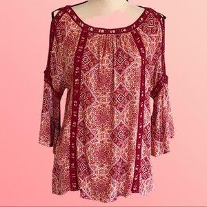 KAKTUS cold shoulder blouse with crochet accents.